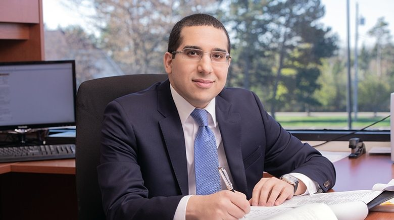Attorney Matthew Aneese in his office at The Sam Bernstein Law Firm in Farmington Hills, Michigan