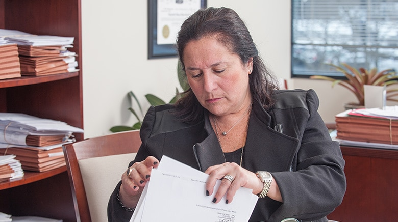 Attorney Elizabeth Klein working in her office at The Sam Bernstein Law Firm in Farmington Hills, Michigan