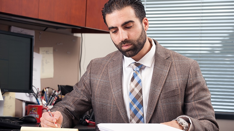 Attorney Brian Zaid working in his office at The Sam Bernstein Law Firm in Farmington Hills, Michigan