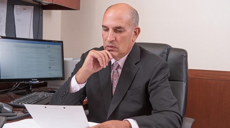 Attorney David Elkin working in his office at The Sam Bernstein Law Firm in Farmington Hills, Michigan