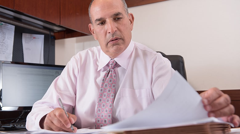 Attorney David Elkin reading in his office at The Sam Bernstein Law Firm in Farmington Hills, Michigan