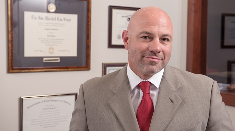 Attorney Joseph Ceglarek in his office at The Sam Bernstein Law Firm in Farmington Hills, Michigan