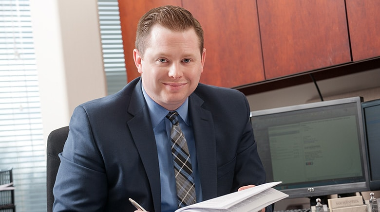 Attorney Justin Drilich working in his office at The Sam Bernstein Law Firm in Farmington Hills, Michigan