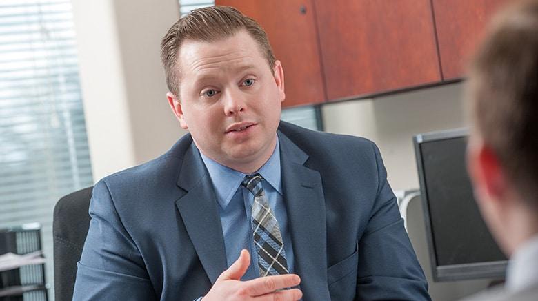 Attorney Justin Drilich speaking in his office at The Sam Bernstein Law Firm in Farmington Hills, Michigan