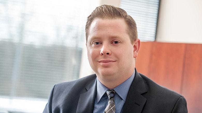 Attorney Justin Drilich in his office at The Sam Bernstein Law Firm in Farmington Hills, Michigan