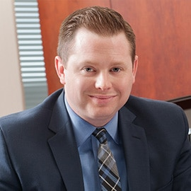 Attorney Justin Drilich in his office at The Sam Bernstein Law Firm in Farmington Hills, Michigan