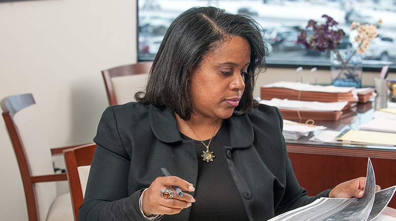 Attorney Lee'ah Basemore working in her office at The Sam Bernstein Law Firm in Farmington Hills, Michigan