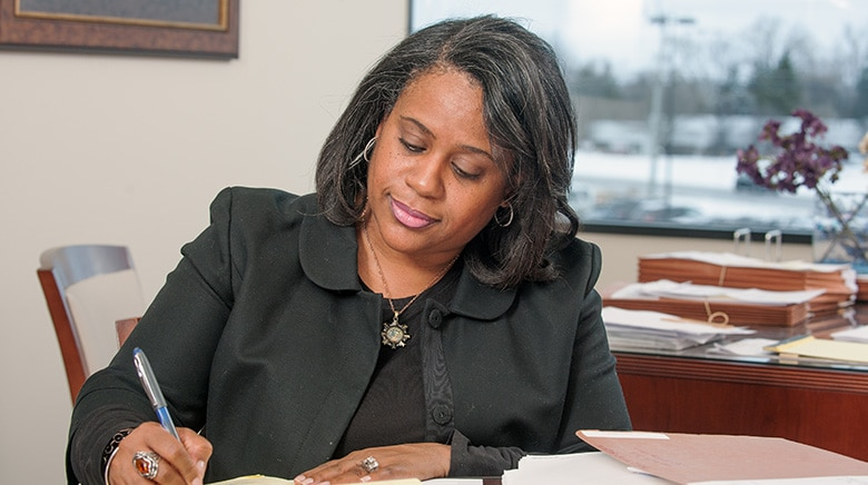 Attorney Lee'ah Basemore reading in her office at The Sam Bernstein Law Firm in Farmington Hills, Michigan