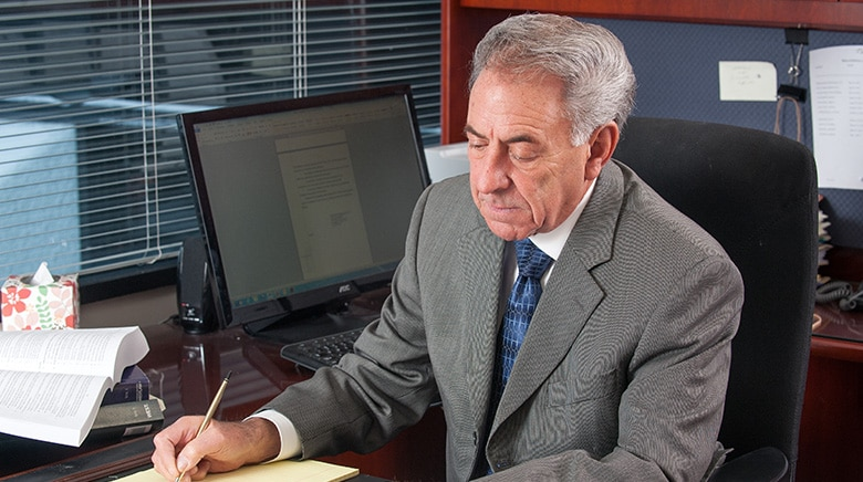 Attorney Leonard Miller working in his office at The Sam Bernstein Law Firm in Farmington Hills, Michigan