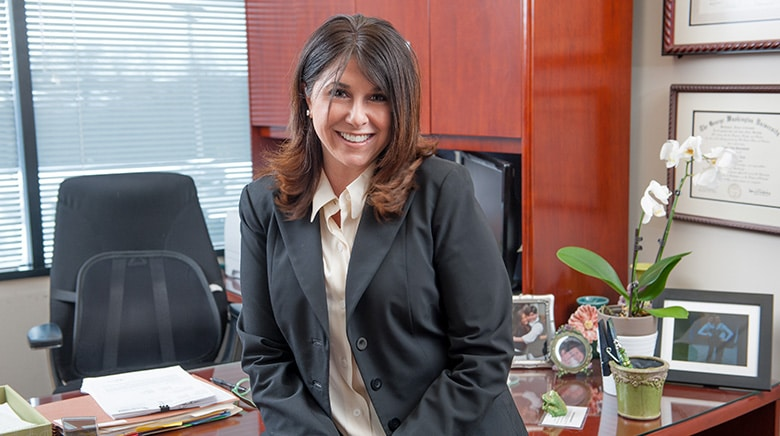 Attorney Lorie Lieberman working in her office at The Sam Bernstein Law Firm in Farmington Hills, Michigan
