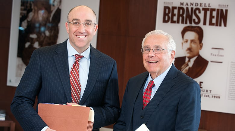 Sam Bernstein and Mark Bernstein in the lobby of The Sam Bernstein Law Firm in Farmington Hills, Michigan