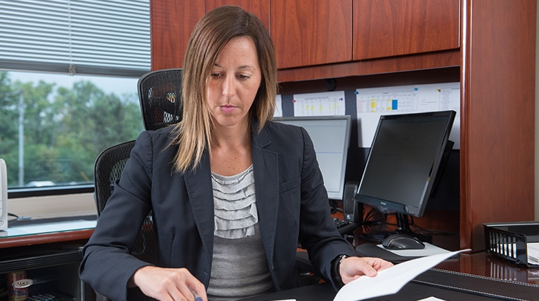 Attorney Stefanie Fryer working in her office at The Sam Bernstein Law Firm in Farmington Hills, Michigan