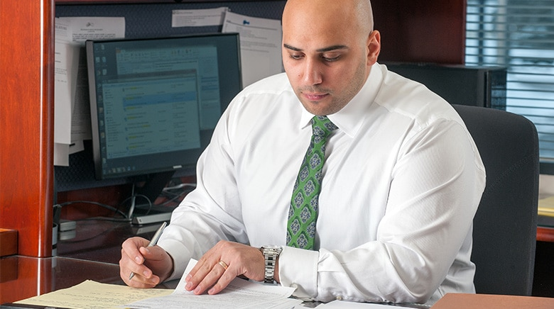 Attorney Alexander Kassab working in his office at The Sam Bernstein Law firm in Farmington Hills, Michigan