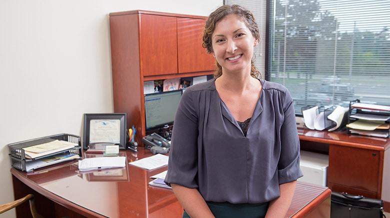 Attorney Cara Kirkpatrick in her office at The Sam Bernstein Law Firm in Farmington Hills, Michigan