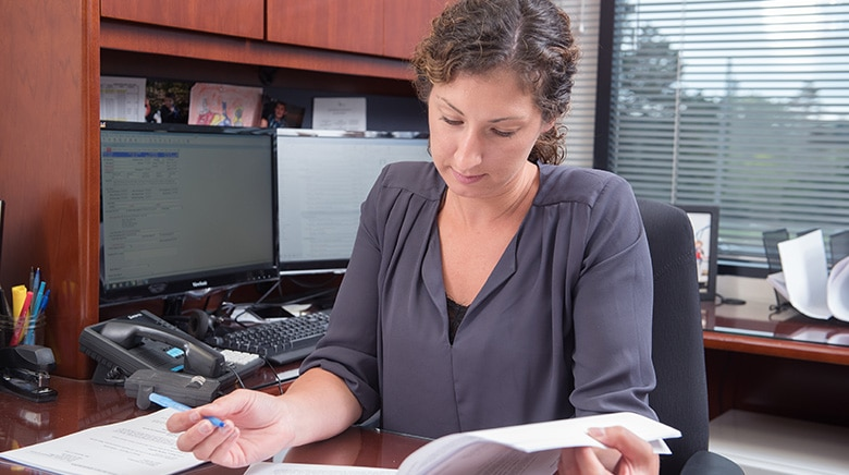 Attorney Cara Kirkpatrick reading in her office at The Sam Bernstein Law Firm in Farmington Hills, Michigan