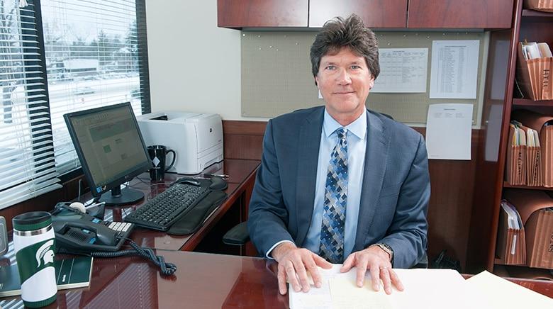 Attorney Nicholas Manikas in his office at The Sam Bernstein Law Firm in Farmington Hills, Michigan