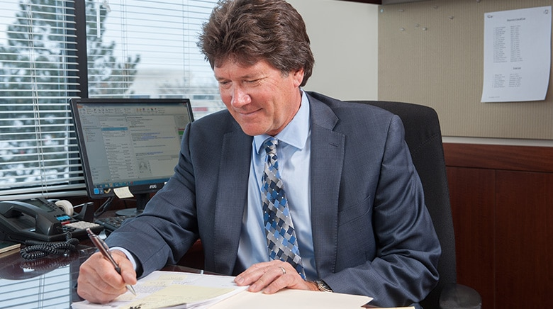Attorney Nicholas Manikas working in his office at The Sam Bernstein Law Firm in Farmington Hills, Michigan