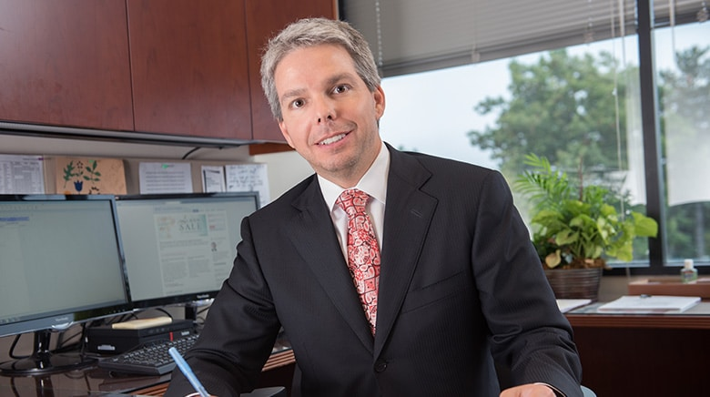 Attorney Daniel Koester in his office at The Sam Bernstein Law Firm in Farmington Hills, Michigan