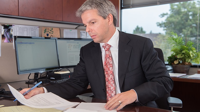 Attorney Daniel Koester working in his office at The Sam Bernstein Law Firm in Farmington Hills, Michigan