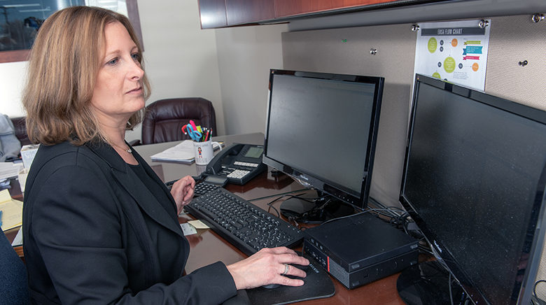 Attorney Shereen Silver working in her office at The Sam Bernstein Law Firm in Farmington Hills, Michigan