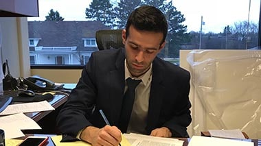 Alex Waldman working in his office at The Sam Bernstein Law Firm in Farmington Hills, Michigan