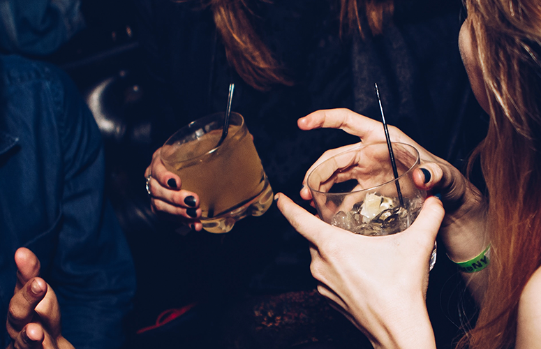 women with drinks in their hands