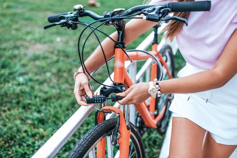 woman locking up bicycle