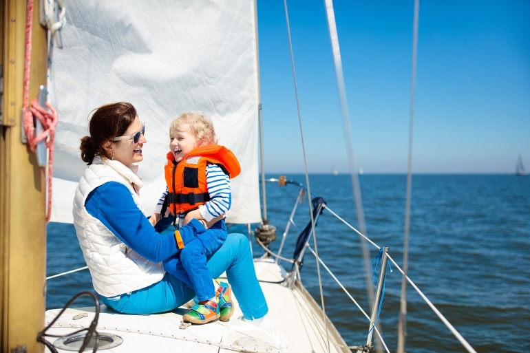 mother and child on boat, life jacket