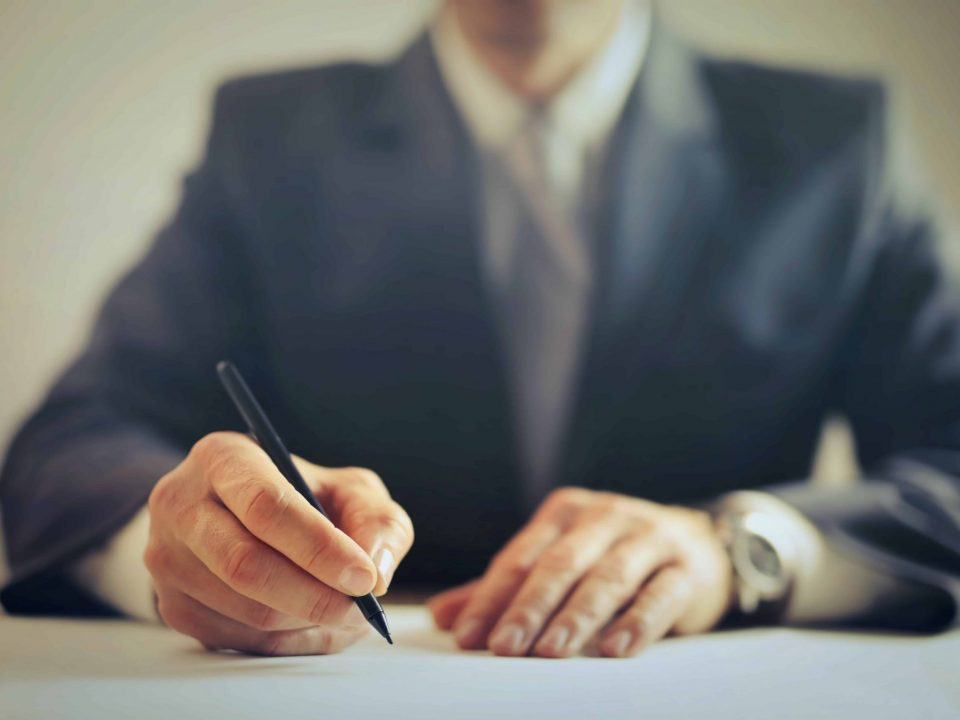 businessman writing with pen