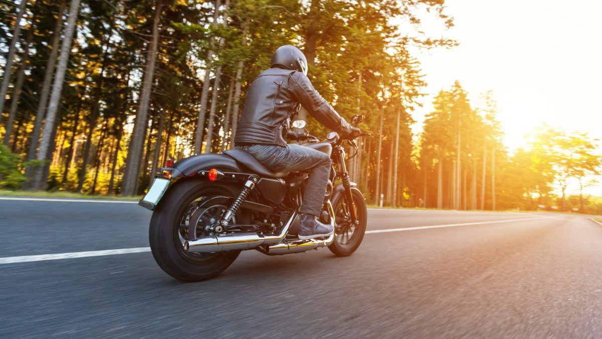 Motorcycle riding down road